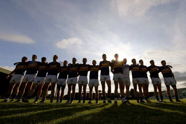 Tipperary players stand together for the national anthem