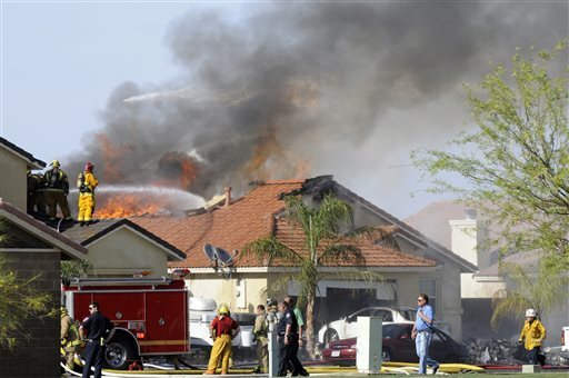 Witnesses say two houses caught fire after the crash. (
