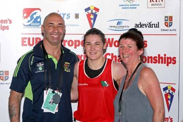 Katie Taylor celebrates winning a gold medal with father Peter and mother Bridget