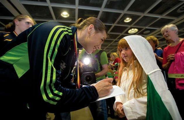 Katie Taylor signs an autograph for Grace Carruth