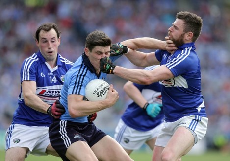 Conor Meredith and Paul Begley with Diarmuid Connolly