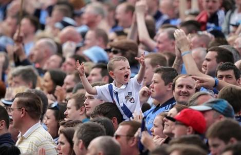 A young Dublin fan cheers