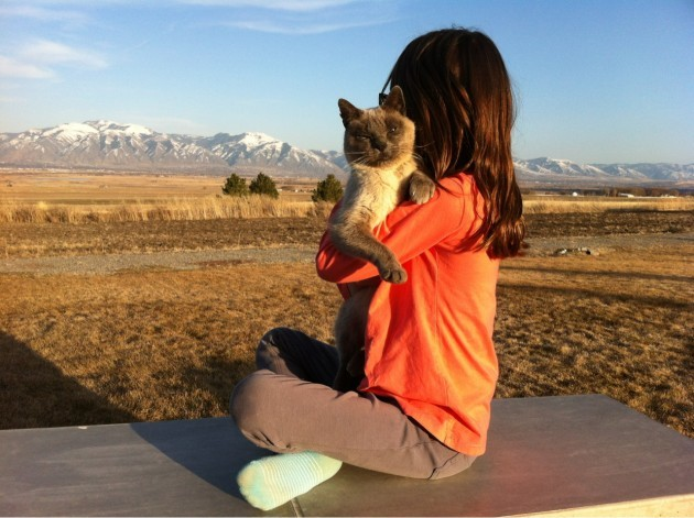 Our daughter and cat on the patio - Imgur