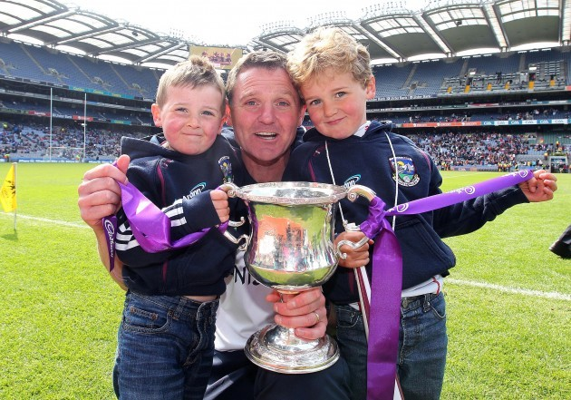 Alan Mulholland celebrates with his sons Tom and Harry