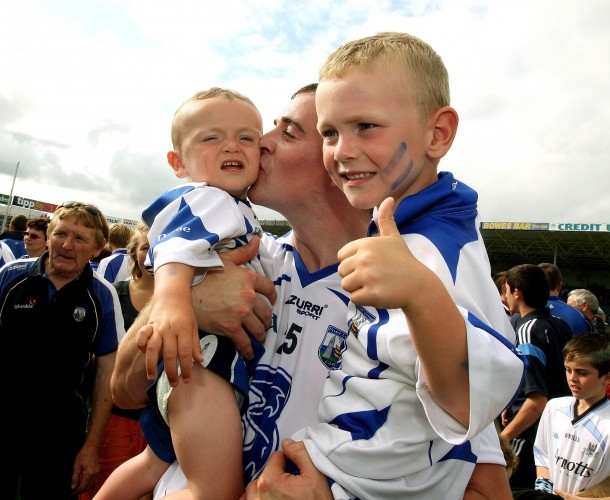 Eoin Kelly celebrates with his two sons