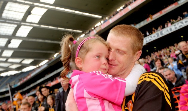 Henry Shefflin hugs his daughter Sadhbh after the game