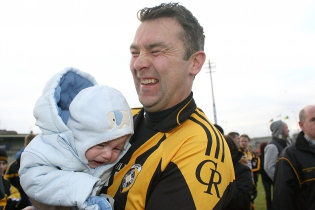 Oisin McConville celebrates with his son Ryan after the game 14/10/2012
