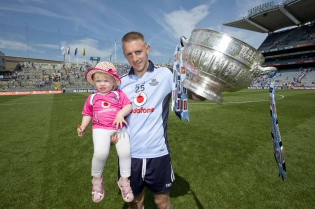 Eoghan O'Gara and daughter Ella celebrate with the Delaney Cup