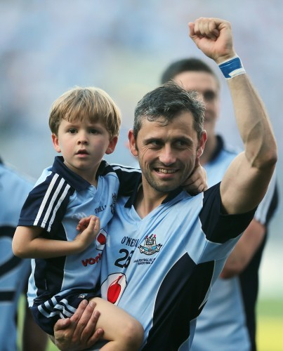 Alan Brogan celebrates after the game with his son Jamie