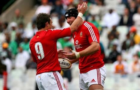 Stephen Ferris celebrates his try with Harry Ellis