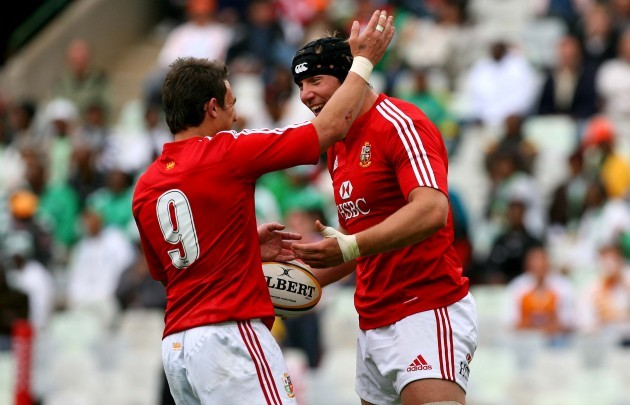 Stephen Ferris celebrates his try with Harry Ellis