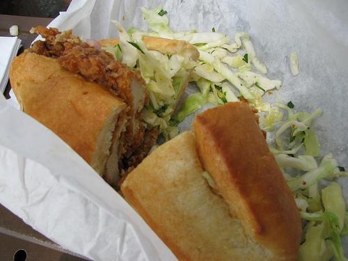 examining a fried chicken sandwich 2