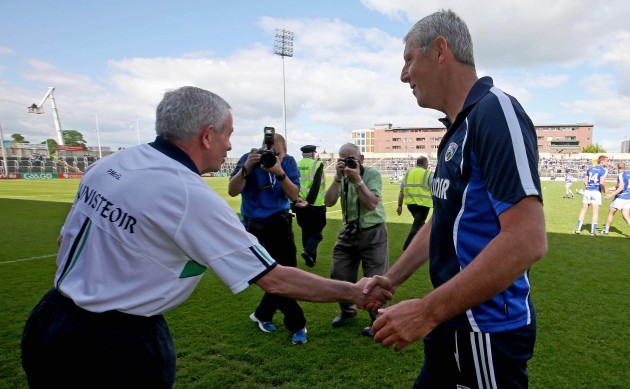 Pete McGrath and Tomas O'Flaharta shake hands at the end of the game