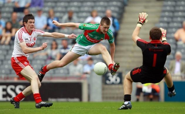 Cillian O'Connor gets a shot away despite the presence of Conor Clarke