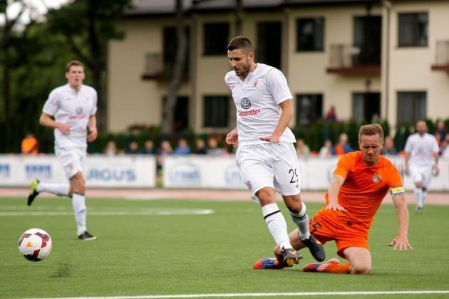 Seamus Conneely gets past Aurelijus Staponka