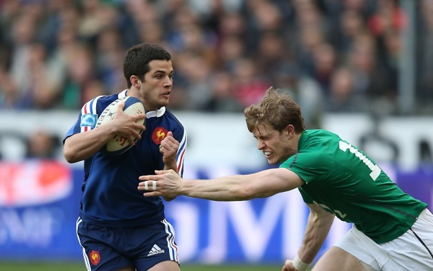 Brice Dulin is tackled by Andrew Trimble