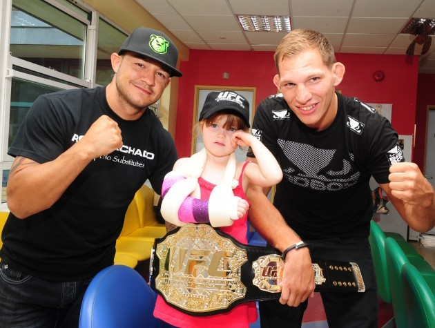 She?s the champ! UFC stars pay a surprise visit to patients at the National Children?s Hospital, Tallaght. Cub Swanson and Luke Barnatt are pictured with Emily Doyle Weston (4 years old) from Arklow, Co. Wicklow.