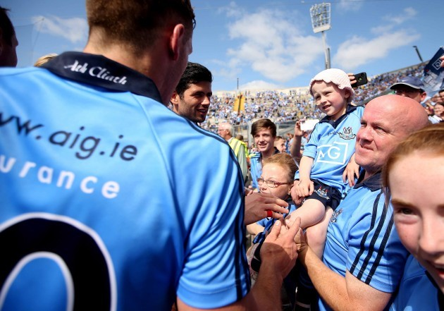 Dublin players bring the trophy to fan Molly McNally after the game