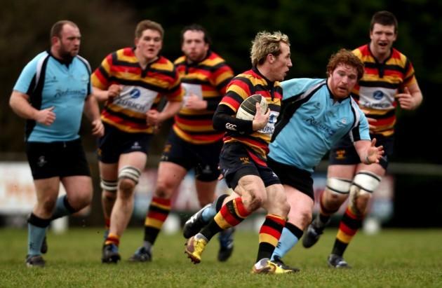 Eoghan Hickey runs at Jamie Stephens