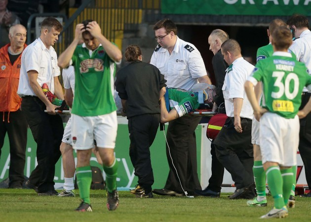 Cork City's Brian Lenihan is taken off injured 25/72014