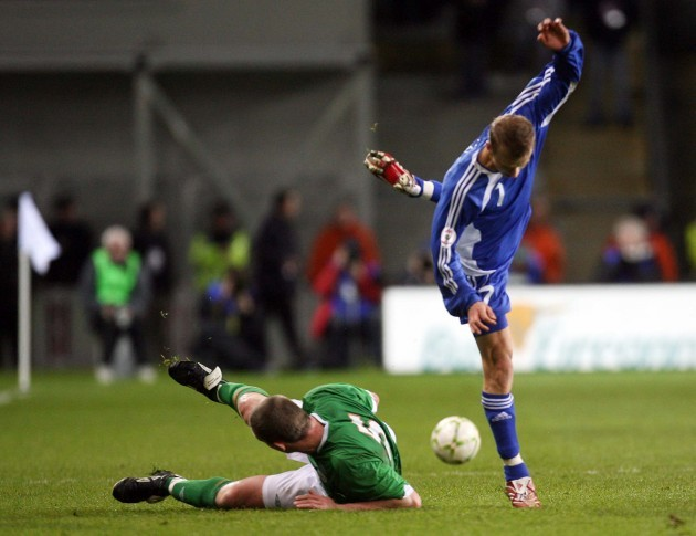 Richard Dunne slide tackles Marek Sapara