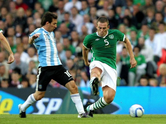 Richard Dunne and Lionel Messi