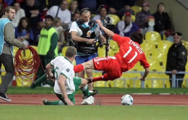 Richard Dunne tackles Yuri Zhirkov