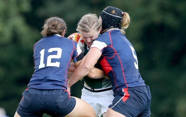 Claire Molloy tackled by Emilie Bydwell and Sarah Walsh