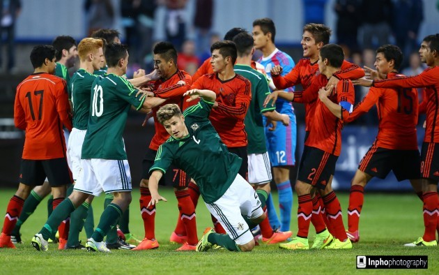 Northern Ireland and Mexico players clash during the game