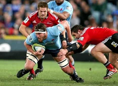 Kane Douglas tackled by Corey Flynn and Richie McCaw