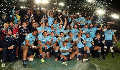 The Waratahs team celebrate winning