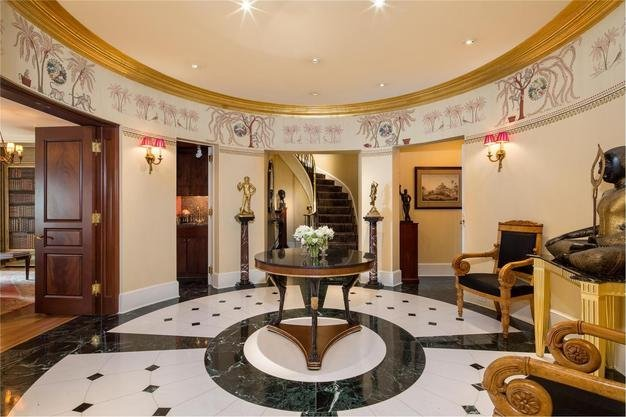 the-apartments-lower-level-welcomes-guests-in-with-a-grand-reception-gallery-with-wet-bar-and-powder-room