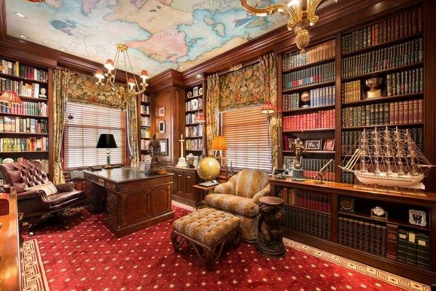 the-library-includes-mahogany-bookshelves-and-window-frames