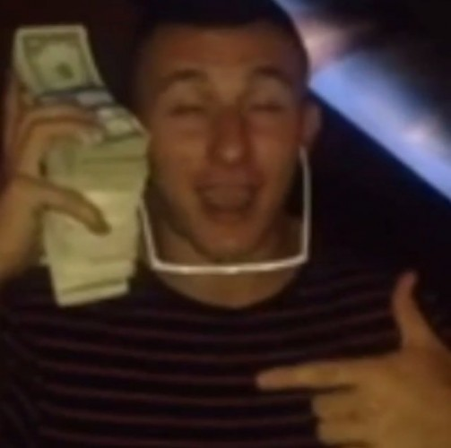 he-held-a-stack-of-money-up-to-his-ear-like-a-phone-after-getting-drafted