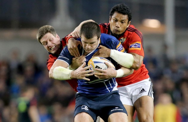 Ronan O'Gara and Casey Laulala tackle Shane Jennings