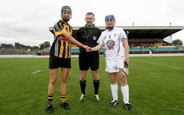 Mags Fennelly and Aine Fahey with referee John Dolan