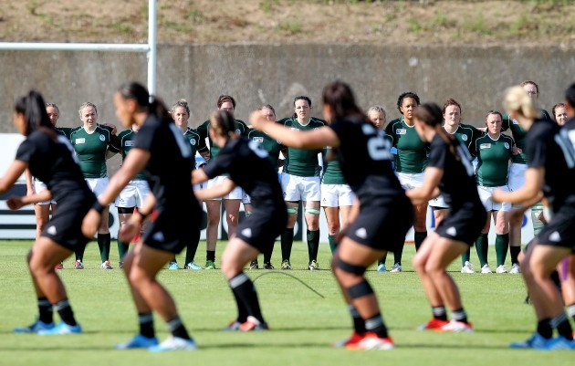 The Ireland players line up as the New Zealand players perform the Haka before