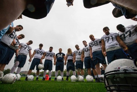 Penn State players say a prayer after training