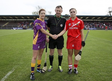 Kate Kelly and Anna Geary with referee John Dolan at the coin toss