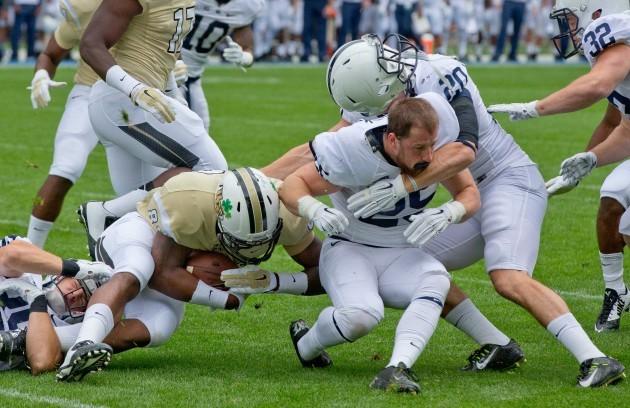 Vonn Walker has his helmet knocked off in a tackle