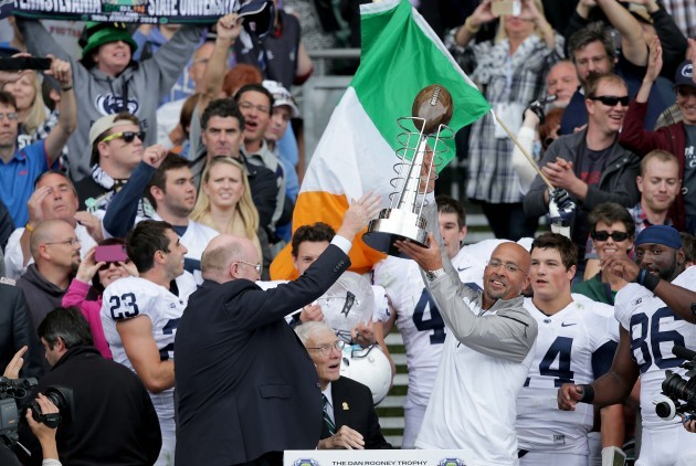 James Franklin lifts the Dan Rooney trophy