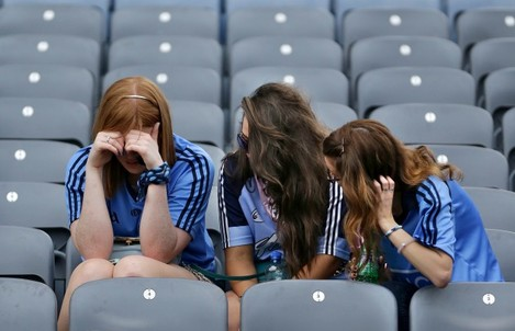 Dejected Dublin fans console each other after the game