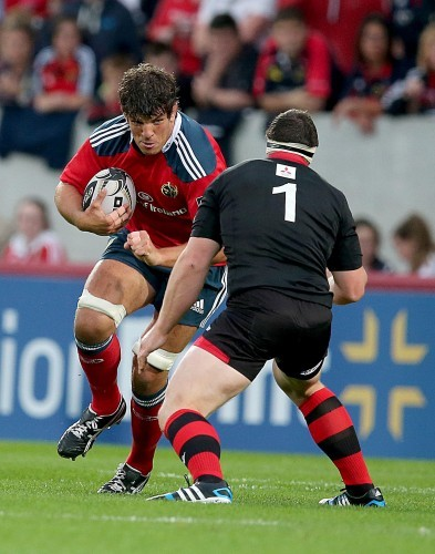 Donncha O'Callaghan runs at Alasdair Dickinson