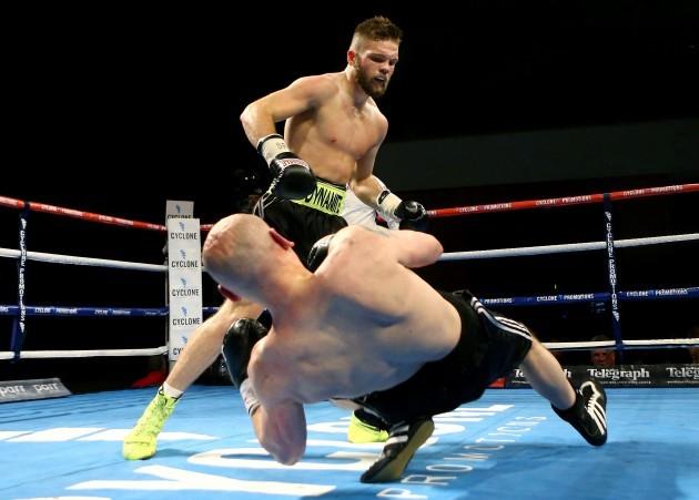 Conrad Cummings knocks down Lajos Munkacsi