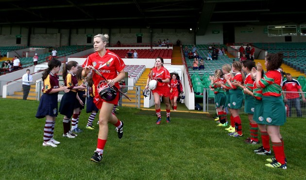 Anna Geary leads out her team