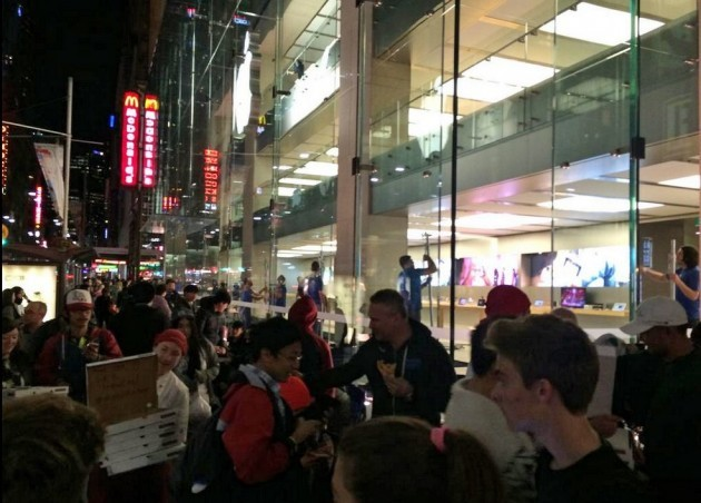 pizza-is-handed-out-to-those-waiting-in-line-in-sydney-australia