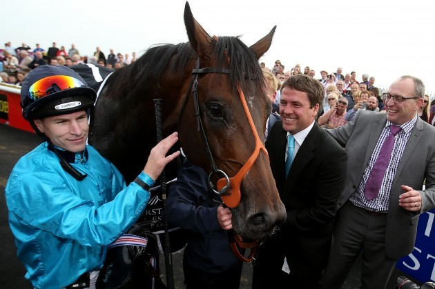 Richard Kingscote celebrates winning with owner Michael Owen