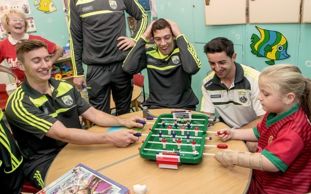 James O'Donoghue, Anthony Maher and Aidan O'Mahony play a game with Abigail Bradshaw