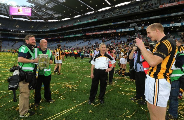 Henry Shefflin takes a picture of photographers Eoin Hennessy and John McIlwaine