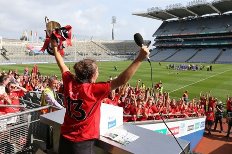 Niamh Mallon lifts the Kay Mills cup